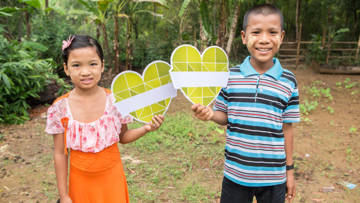 Zin Thu Thu and Martin with green hearts