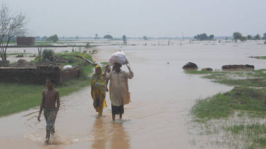 Heavy monsoon rains in Pakistan destroyed thousands of homes, roads, bridges and farms in August 2013.