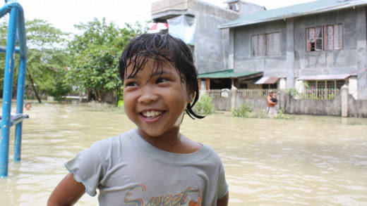A boy in the floods
