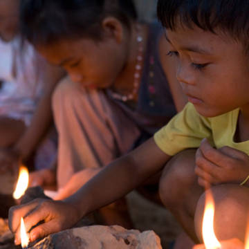 Lighting candles in the Philippines
