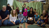 CAFOD volunteers Leah and Ryan with Caritas Lebanon staff and refugee children in a literacy class.