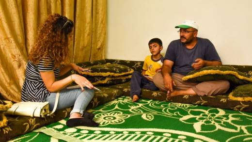 Fadia with a returning family in Syria