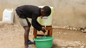 A boy in Kenya washes his hands