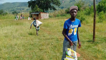 Young man collecting food in Zimbabwe