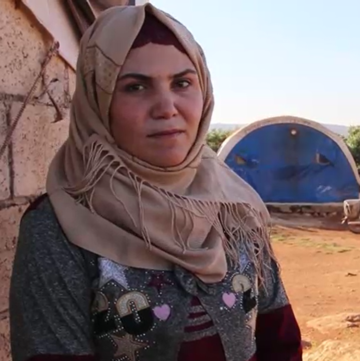 A mother living in a camp