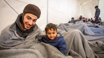 CAFOD partners in Greece provide blankets to brothers from Syria