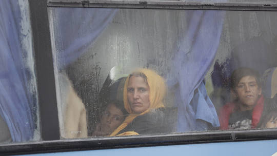 A refugee on a bus in Greece