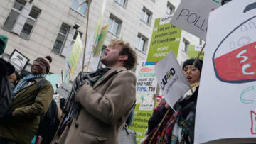 A campaigner leads a chant at a climate change rally.