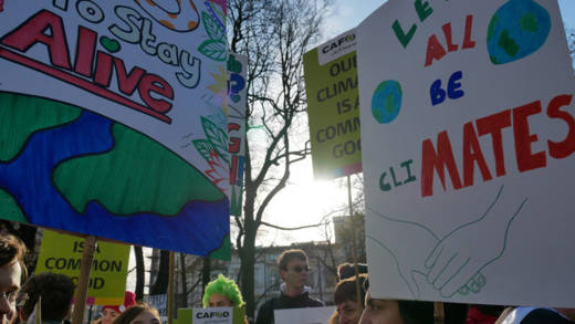 Campaigners holding placards at a climate change march in Poland