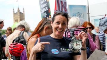 A supporter holds a clock at the Time is Now mass lobby in June 2019