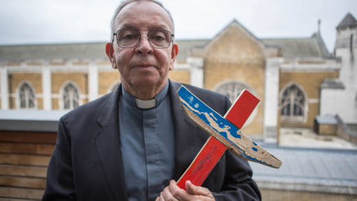 CAFOD's partner Monsignor Hector Fabio Henao is holding a cross and prays for peace in Colombia.
