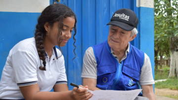 Rosana, a young leader in Colombia, working on her life road map with Father Joaquín.