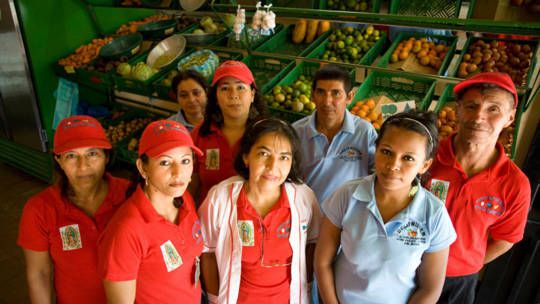 Staff from a small grocery business in Colombia, one of the countries where CAFOD works.