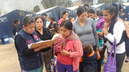 Women queue to receive aid from CAFOD's local partner in Peru, after floods left them with no home or belongings.