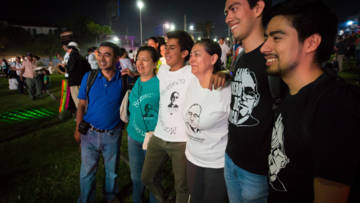 People gather in San Salvador in March 2017 to commemorate Romero on the 37th anniversary of his murder.  They proudly wear their Romero t-shirts.