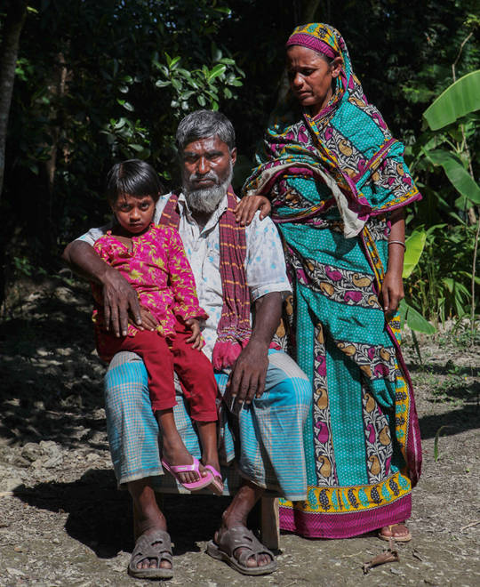 Maria Mallik from Bangladesh with her parents