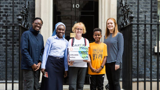 Staff and supporters in Number 10 hand in for Share the Journey