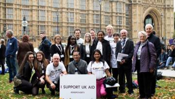 CAFOD supporters outside Parliament calling for MPs to support UK Aid