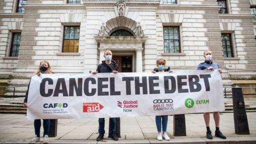 Campaigners outside Treasury with Cancel the Debt banner