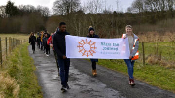 Young people at St Cassian's retreat centre join the Share the Journey walk with CAFOD.