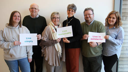CAFOD supporters with livesimply signs