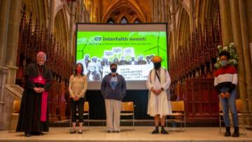 Five people representing different faiths standing on the stage in Truro cathedral