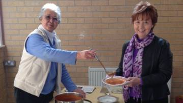 Supporters serving soup and rolls for CAFOD's Family Fast Day