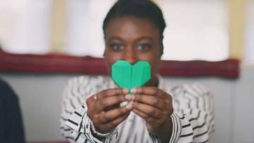 A green heart made from paper