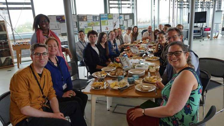 CAFOD staff and volunteers sharing a meal for their Creation Celebration at Romero House.