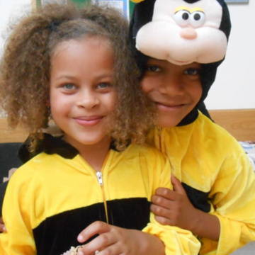 Two young CAFOD supporters dressed as bees