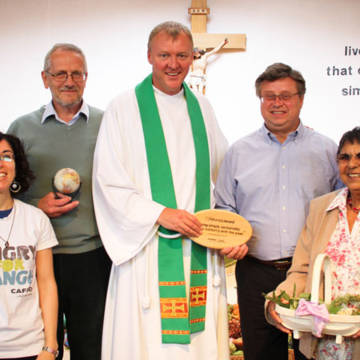 St John Bosco parish receive their LiveSimply award from CAFOD Director Chris Bain