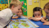 Primary school children using CAFOD teaching resources.