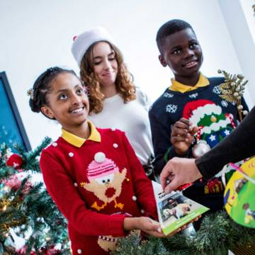 School children fundraising for World Gifts that change lives, with a Christmas bauble sale for CAFOD.