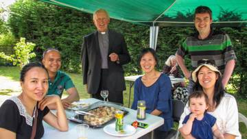Fr Tom Cooper and volunteers celebrate earning the livesimply award at St James, Petts Wood