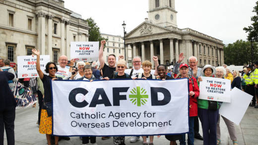 Volunteers holding a CAFOD banner.