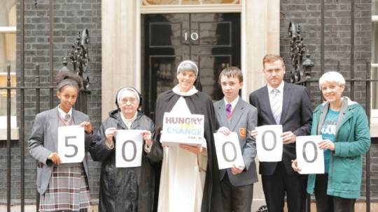 CAFOD supporters hand in 50,000 demands for action on hunger to Number 10.