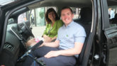 CAFOD supporter Jason spoke to Climate Minister Claire Perry about climate change in an electric vehicle