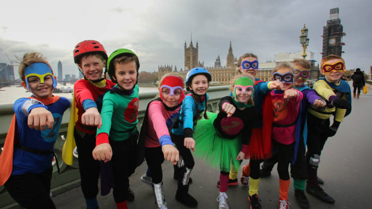 The 10-year-olds wore 'Zero Heroes' costumes to ask MPs to be superheroes on climate change