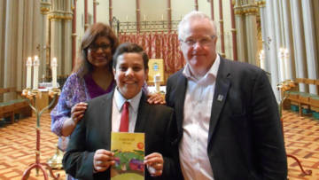 Boy with parents receiving a World Gift for his Confirmation present