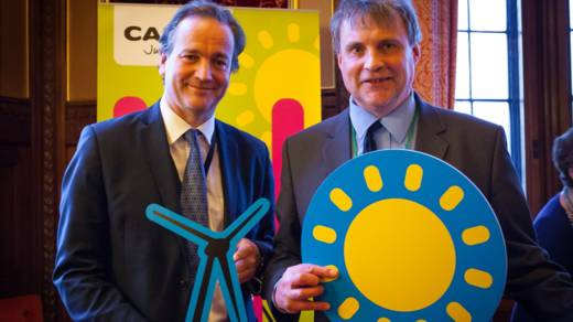 Aid minister Nick Hurd MP (left) joins CAFOD supporters calling for renewable energy to tackle poverty