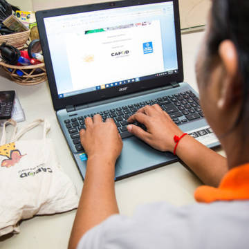 A woman sat at her laptop in an office in Siem Reap, Cambodia