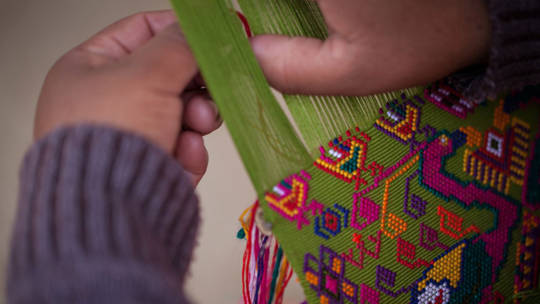 Juana weaving a traditional Mayan pattern.
