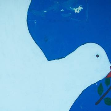 A mural of a dove in El Salvador, CAFOD