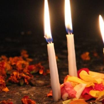 An offering of flowers and candles in Guatemala.