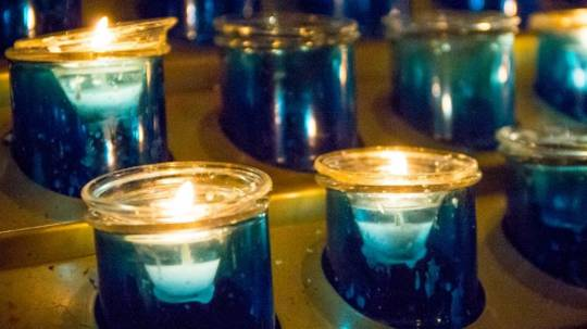 Votive candles flicker in Buckfast Abbey, Plymouth diocese.