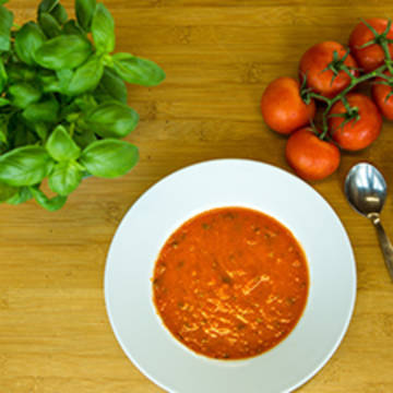 A bowl of tomato and basil soup