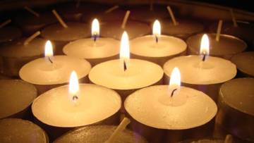 A collection of lit votive candles