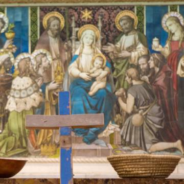 An altar showing with the Holy Family and a Lampedusa cross