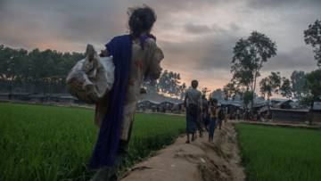 Rohingya refugees walk into Kutupalong camp in southern Bangladesh