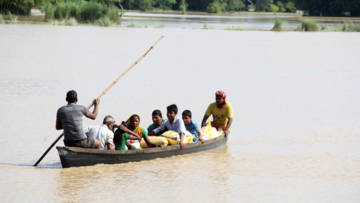 People in Nepal affected by flooding heading home after receiving support from CAFOD's partner, Caritas Nepal